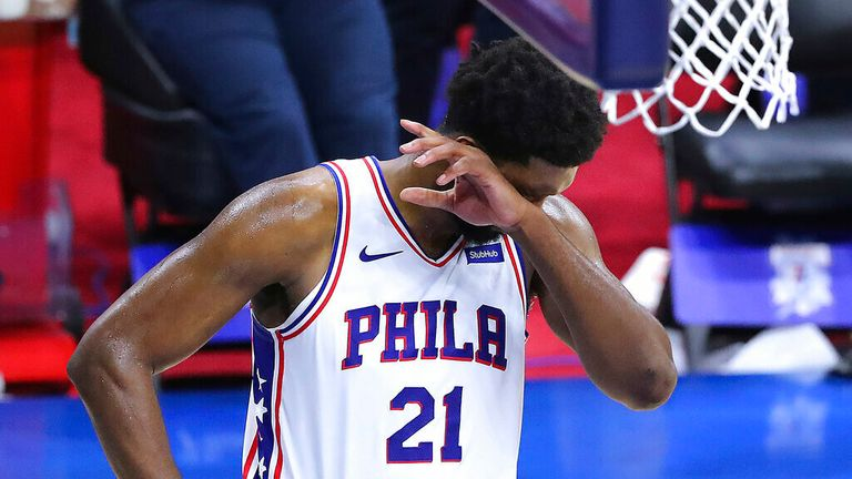 Philadelphia 76ers center Joel Embiid reacts in the final seconds of a 103-96 loss to the Atlanta Hawks in Game 7 of their NBA Eastern Conference semifinal basketball game, Sunday, Jun 20, 2021, in Philadelphia. (Curtis Compton/Atlanta Journal-Constitution via AP)
