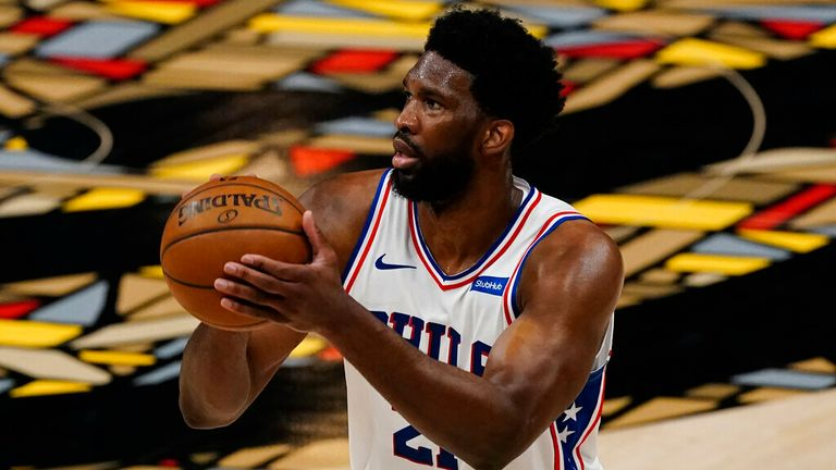 Philadelphia 76ers center Joel Embiid (21) shoots during the first half of Game 6 of an NBA basketball Eastern Conference semifinal series Friday, June 18, 2021, in Atlanta. (AP Photo/John Bazemore)