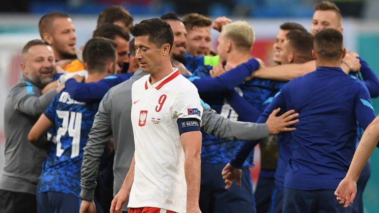 Slovakia celebrate at full-time as Poland captain Robert Lewandowski leaves the field
