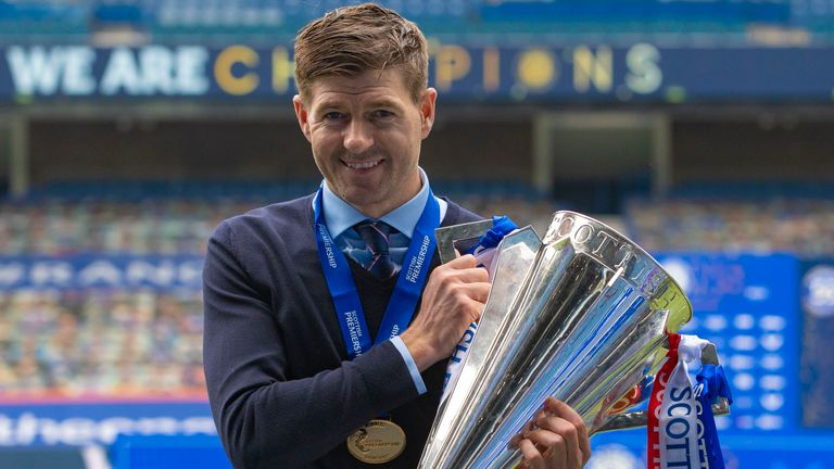 GLASGOW, SCOTLAND - MAY 15: Steven Gerrard celebrates with the Scottish Premiership Trophy at full time during the Scottish Premiership match  between Rangers and Aberdeen  at Ibrox Stadium, on May 15, 2021, in Glasgow, Scotland. (Photo by Craig Williamson / SNS Group)