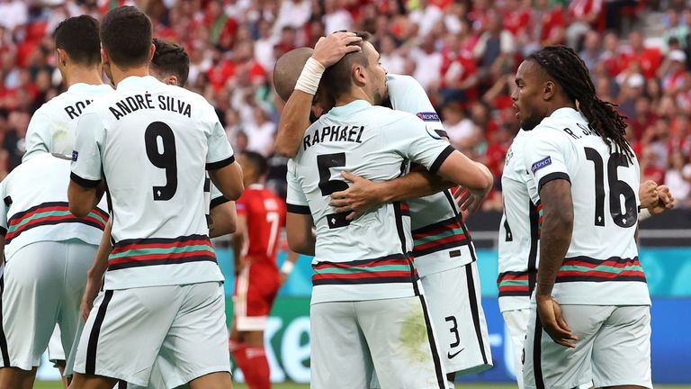 Raphael Guerreiro of Portugal celebrates with Pepe and team-mates after scoring against Hungary