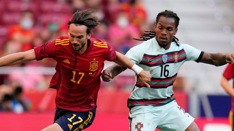 Spain's Fabian Ruiz, left, gets past Portugal's Renato Sanches during the international friendly soccer match between Spain and Portugal at the Wanda Metropolitano stadium in Madrid, Spain on Friday June 4, 2021. (AP Photo/Manu Fernandez)