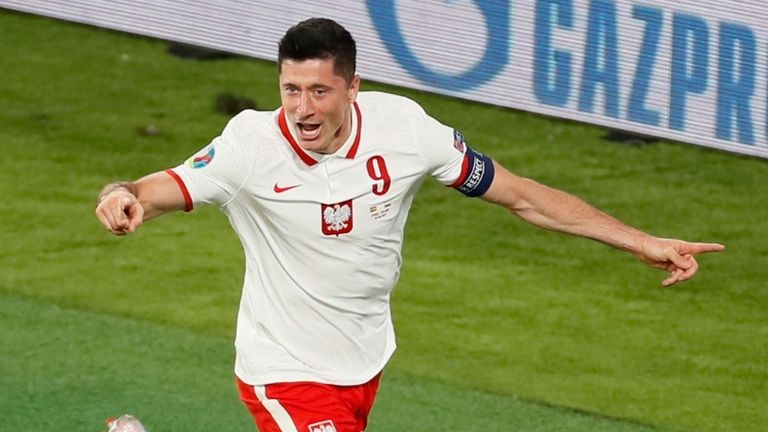Poland's Robert Lewandowski celebrates scoring against Spain
