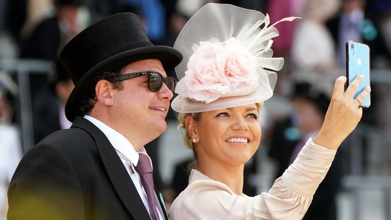 All smiles in the sun as two racegoers pose for a selfie on the opening day of Royal Ascot