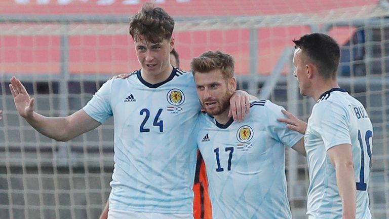 Scotland's Jack Hendry, 2nd left, celebrates with team mates after scoring his side's opening goal during the international friendly soccer match between the Netherlands and Scotland at the Algarve stadium outside Faro, Portugal, Wednesday June 2, 2021. (AP Photo/Miguel Morenatti)