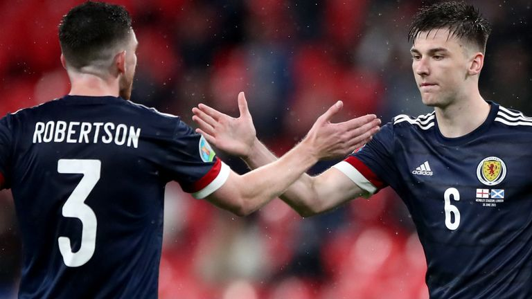 Andy Robertson and Kieran Tierney celebrate Scotland's goalless draw with England at Wembley (PA)