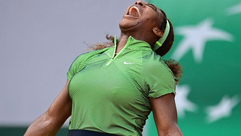 Serena Williams celebrates following her three-set victory over Romania's Mihaela Buzarnescu at Roland Garros