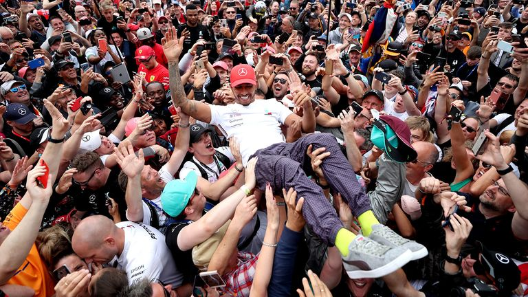 Mercedes' Lewis Hamilton celebrates with fans after winning the British Grand Prix at Silverstone