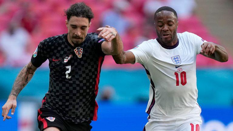 Sime Vrsaljko and Raheem Sterling battle for the ball