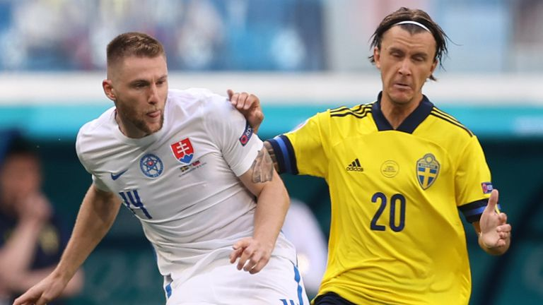 Slovakia's Milan Skriniar makes a pass while under pressure from Sweden's Kristoffer Olsson