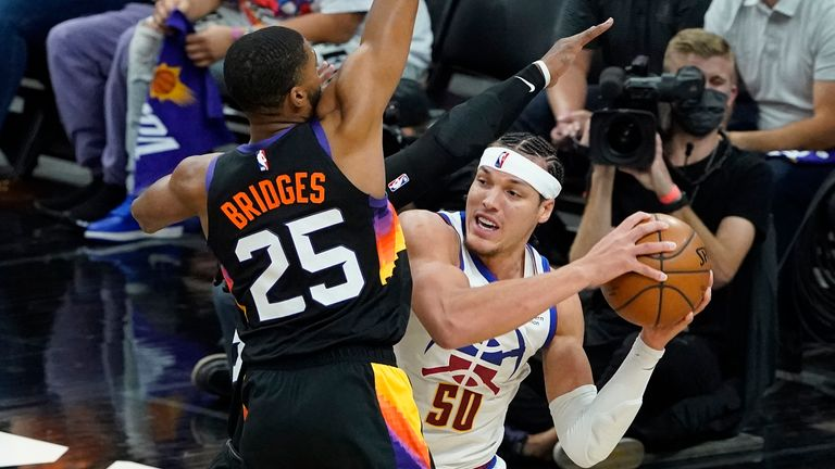 Phoenix Suns forward Mikal Bridges pressures Denver Nuggets forward Aaron Gordon during the second half of Game 2 of an NBA basketball second-round playoff series