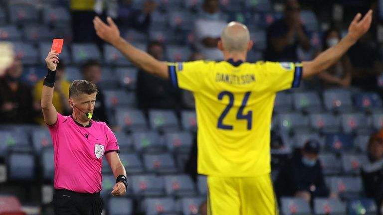 Referee Daniele Orsato shows a red card to Sweden's defender Marcus Danielsson