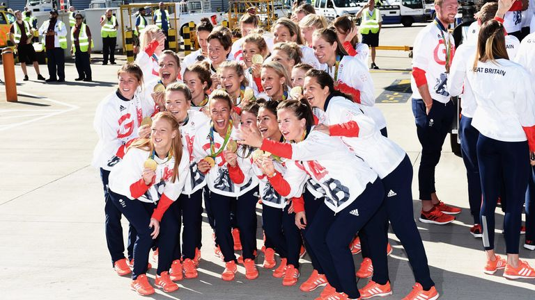 Team GB's women's hockey squad pose with their gold medals after arriving home from the Rio 2016 Games