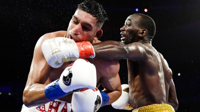 Terence Crawford, right, punches England...s Amir Khan during the fifth round of a WBO world welterweight championship boxing match Sunday, April 21, 2019, in New York. Crawford won the fight. (AP Photo/Frank Franklin II)