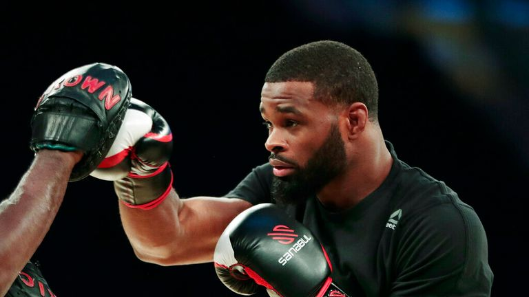 In this Nov. 9, 2016, file photo, Tyron Woodley works out ahead of his UFC 205 mixed martial arts bout against Stephen Thompson  (AP Photo/Julio Cortez, File)