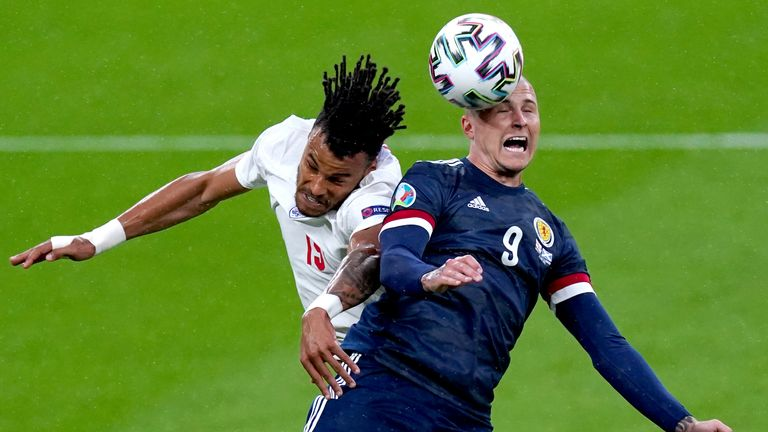 Tyrone Mings and Scotland's Lyndon Dykes battle for the ball during England vs Scotland