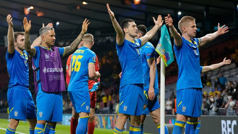 Ukraine players celebrate their extra-time win over Sweden