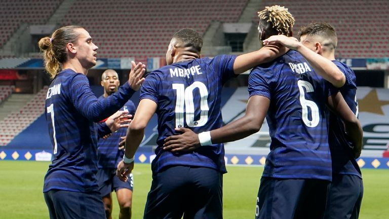 France's Kylian Mbappé, center, celebrates after scoring his side's opening goal during the international friendly soccer match between France and Wales at the Allianz Riviera stadium in Nice, France, Wednesday, June 2, 2021. (AP Photo/Daniel Cole)