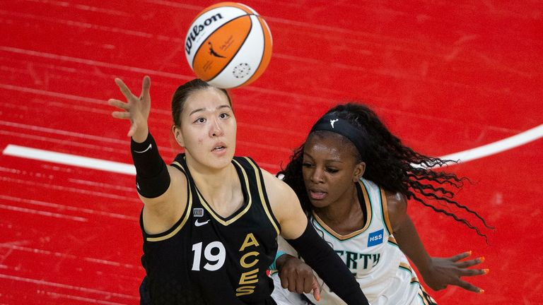 Las Vegas Aces center JiSu Park (19) reaches for control of the ball while New York Liberty forward Michaela Onyenwere (12) defends during a WNBA basketball game Tuesday, June 15, 2021, in Las Vegas.