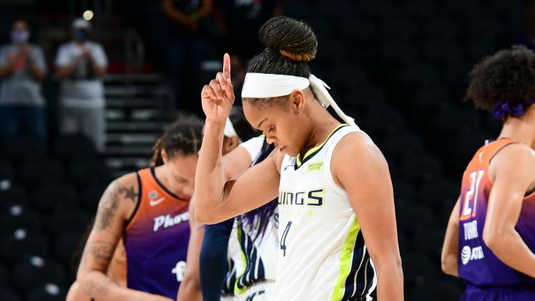 JUNE 11: Moriah Jefferson #4 of the Dallas Wings points before the game against the Phoenix Mercury on June 11, 2021 at Phoenix Suns Arena in Phoenix, Arizona.