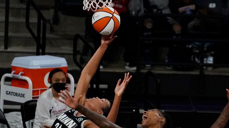 Minnesota Lynx forward Napheesa Collier, left, and Atlanta Dream' Crystal Bradford, right, battle under basket in the first half of their WNBA playoff game Wednesday, June 23, 2021, in College Park, Ga. (AP Photo/John Bazemore) Minnesota Lynx