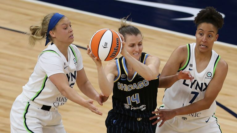Chicago Sky's Allie Quigley (14) works between Minnesota Lynx's Rachel Banham (15) and Layshia Clarendon (7) during the second half of a WNBA basketball game Tuesday, June 15, 2021, in Minneapolis. Chicago won 105-89.