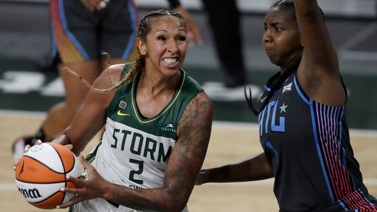Seattle Storm center Mercedes Russell (2) drives the ball against Atlanta Dream forward Elizabeth Williams, right, during the second half of a WNBA basketball game Friday, June 11, 2021, in College Park, Ga.