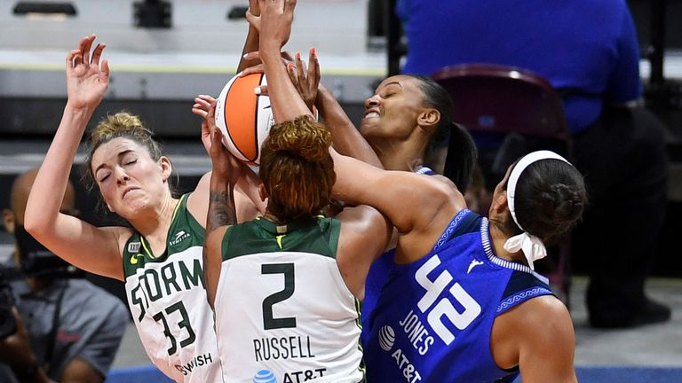 Connecticut Sun forward DeWanna Bonner, back, and center Brionna Jones (42) battle Seattle Storm forward Katie Lou Samuelson (33) and center Mercedes Russell (2) for the rebound during a WNBA basketball game Sunday, June 13, 2021 at Mohegan Sun Arena in Uncasville, Conn.