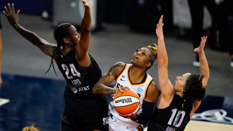 Indiana Fever guard Tiffany Mitchell shoots between Seattle Storm guard Jewell Loyd, left, and guard Sue Bird in the first half of an WNBA basketball game in Indianapolis, Tuesday, June 15, 2021.