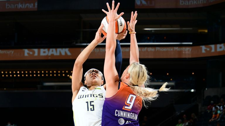 JUNE 11: Allisha Gray #15 of the Dallas Wings shoots the ball during the game against the Phoenix Mercury on June 11, 2021 at Phoenix Suns Arena in Phoenix, Arizona.