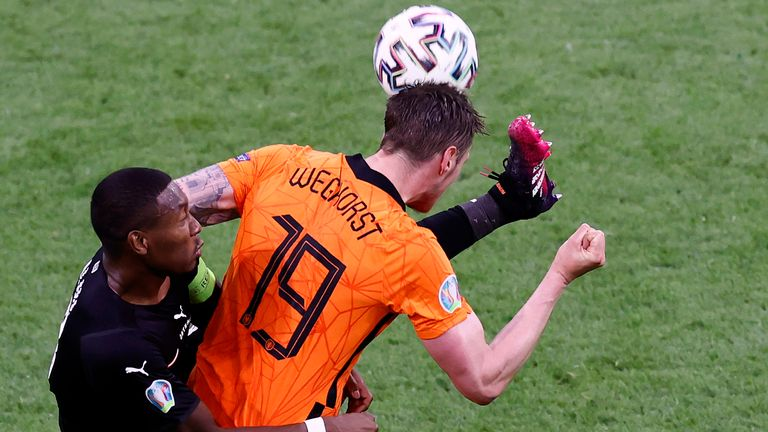 Wout Weghorst of the Netherlands, right, challenges for the ball with Austria's David Alaba during the Euro 2020 soccer championship group C match between Netherland and Austria, at Johan Cruyff Arena in Amsterdam, Thursday, June 17, 2021. (Koen van Weel, Pool via AP)