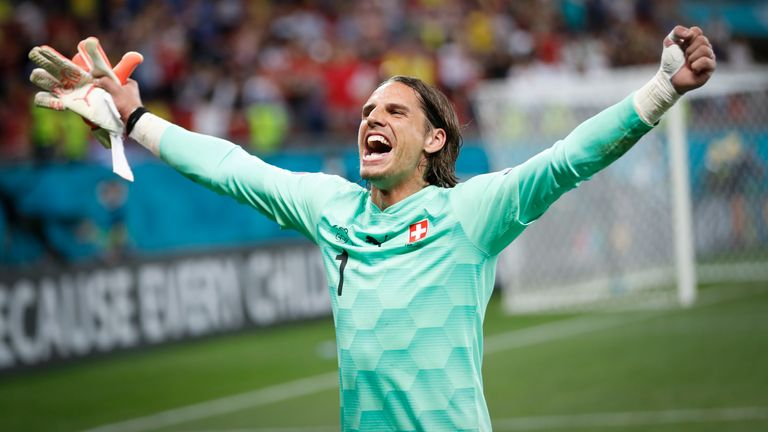Switzerland's goalkeeper Yann Sommer celebrates saving the penalty kick of France's Kylian Mbappe during the Euro 2020 soccer championship round of 16 match between France and Switzerland at the National Arena stadium in Bucharest