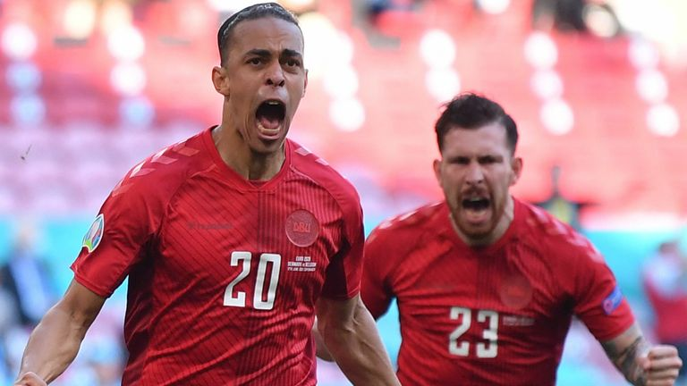 Yussuf Poulsen celebrates after giving Denmark an early lead against Belgium