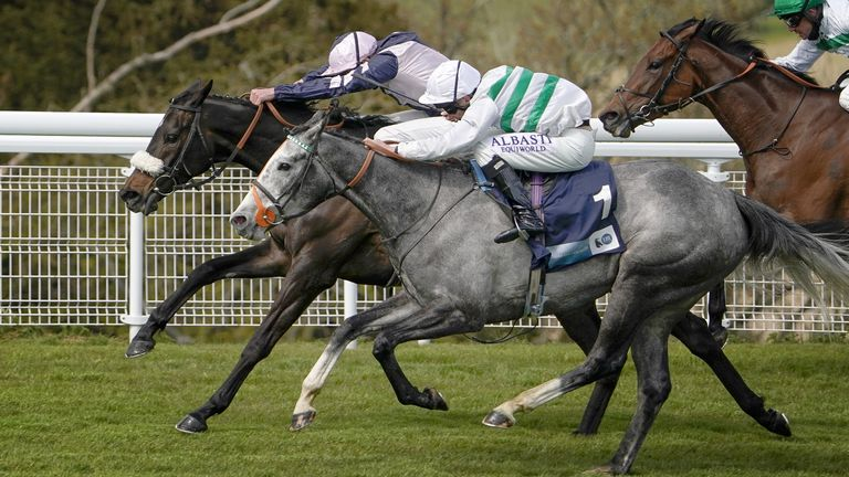 Luke Morris riding Alpinista (grey, nearest) coming home to win The British Stallion Studs EBF Daisy Warwick Fillies' Stakes from Makawee and James Doyle (pink) at Goodwood Racecourse in Chichester. Picture date: Friday April 30, 2021.