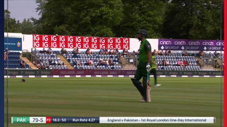 Maqsood trudges off after being run out by Vince at the non-striker's end