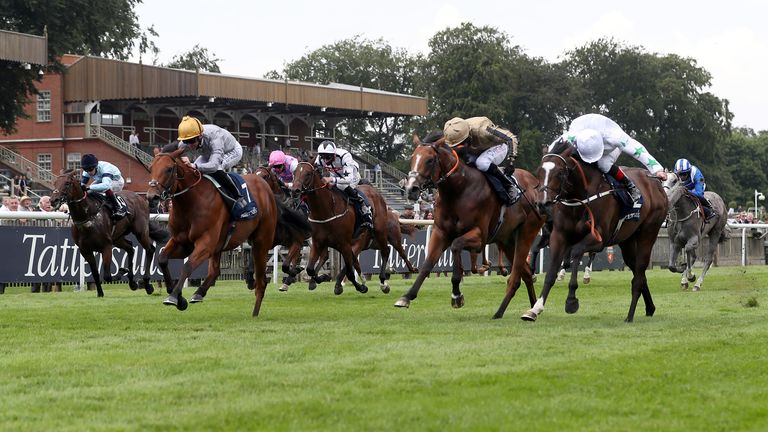 Lusail ridden by jockey Pat Dobbs on their way to winning the Tattersalls July Stakes during Ladies Day of the 2021 Moet and Chandon July Festival at Newmarket racecourse. Picture date: Thursday July 8, 2021.