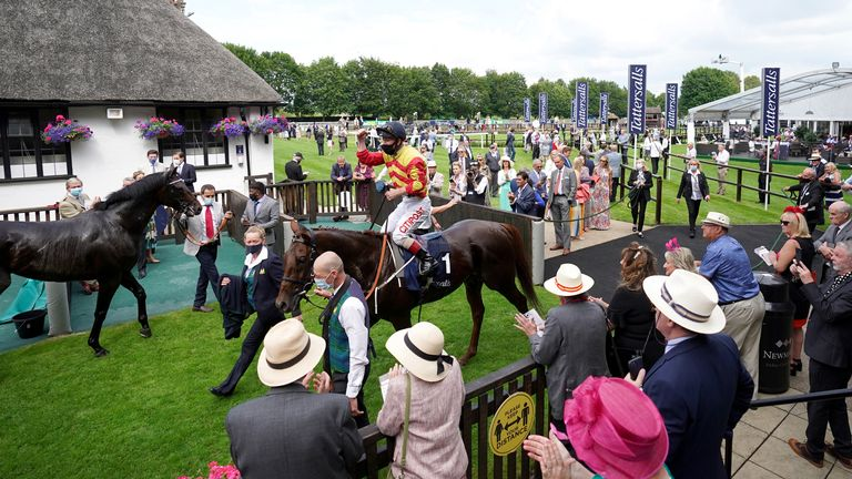 Franny Norton celebrates on Sir Ron Priestley as they are lead into the winners enclosure after winning the Princess Of Wales's Tattersalls Stakes during Ladies Day of the 2021 Moet and Chandon July Festival at Newmarket racecourse. Picture date: Thursday July 8, 2021.