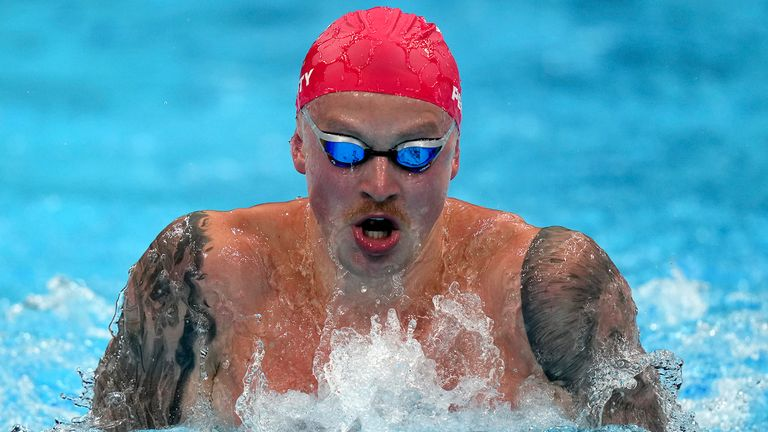 Adam Peaty, of Great Britain, swims in his heat of the men's 100m breaststroke at the 2020 Summer Olympics, Saturday, July 24, 2021, in Tokyo, Japan
