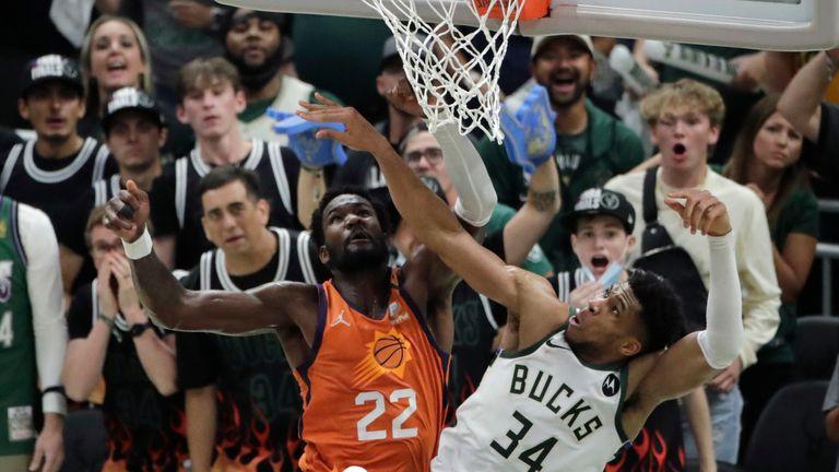 Milwaukee Bucks forward Giannis Antetokounmpo blocks a shot by Phoenix Suns center Deandre Ayton