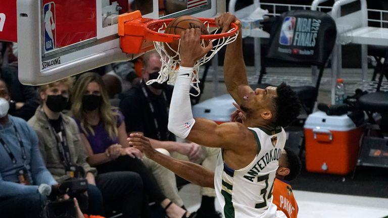 Milwaukee Bucks forward Giannis Antetokounmpo dunks the ball over Phoenix Suns forward Cameron Johnson during Game 4 of basketball's NBA Finals