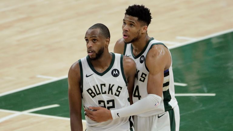 Milwaukee Bucks forward Khris Middleton celebrates with teammate forward Giannis Antetokounmpo at the end of Game 4 against the Phoenix Suns in the NBA Finals