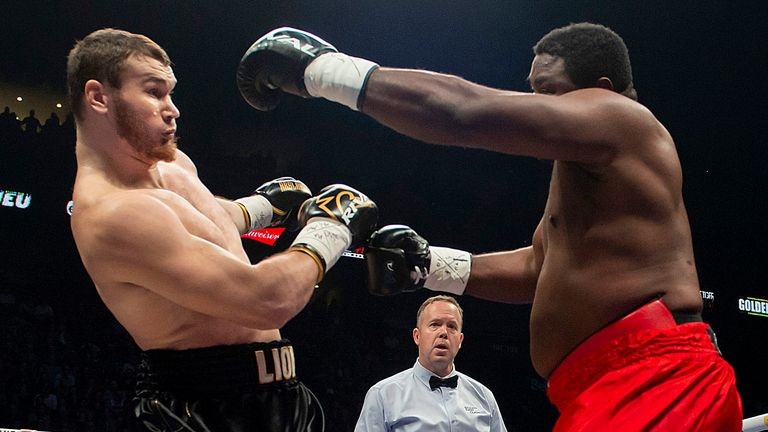 Arslanbek Makhmudov, left, and Samuel Peters battle for the NABE heavyweight title, in Montreal on Sunday, Dec. 8, 2019.
