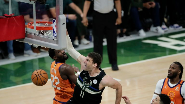 Milwaukee's Brook Lopez slammed home as the Bucks opened up a three-point lead over the Phoenix Suns in the third quarter.