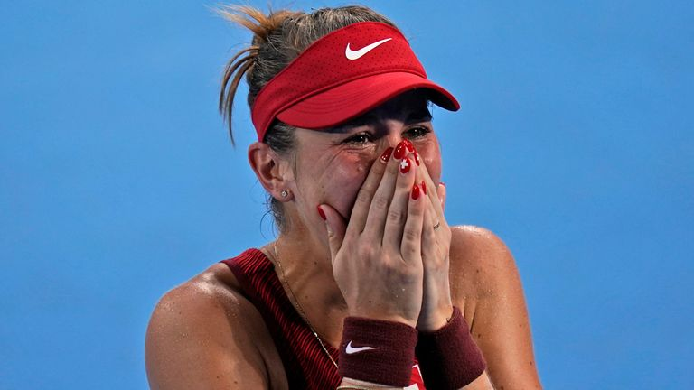 An emotional Belinda Bencic reacts after booking her place in the Olympic women's singles final in Tokyo