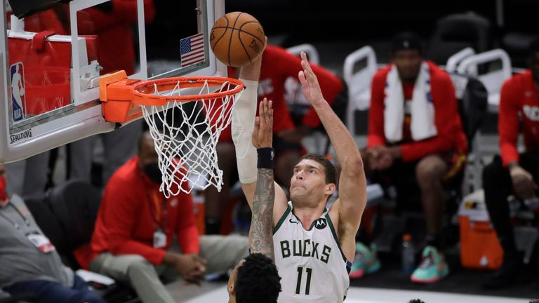 Milwaukee Bucks' Brook Lopez shoots against Atlanta Hawks' John Collins during the second half of Game 5 of the NBA Eastern Conference Finals