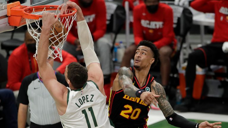 Milwaukee Bucks' Brook Lopez dunks against Atlanta Hawks' John Collins during the second half of Game 5 of the NBA Eastern Conference Finals