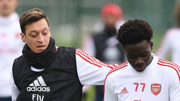 Mesut Ozil and Bukayo Saka were team-mates at Arsenal
