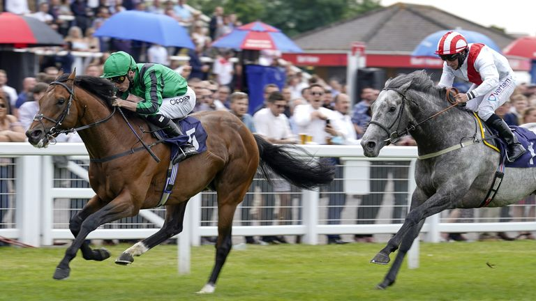 Century Dream (green) beats Top Rank in the Midsummer Stakes at Windsor