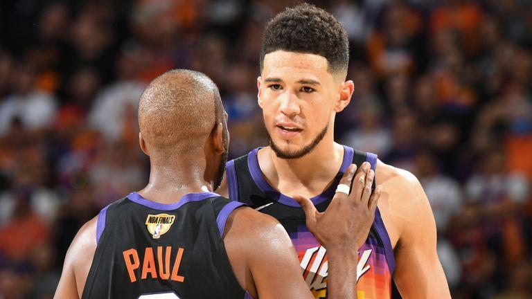 Chris Paul and Devon Booker celebrate Phoenix's win in Game 2 of the NBA Finals