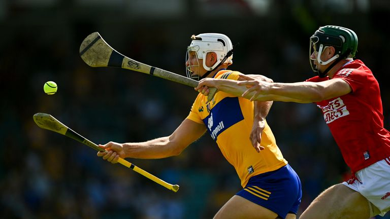 Aron Shanagher of Clare in action against Mark Coleman of Cork